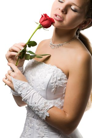 beautiful sensual girl in a wedding dress hold in hands a red rose, isolated on white photo