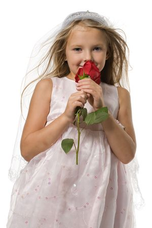 blonde close up: beautiful little girl with long hair holds a red rose, isolated on white Stock Photo