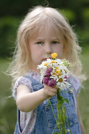 little girl with bunch of flowers in hands Stock Photo - 5909844