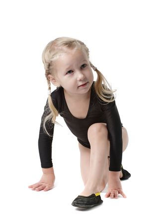 creative strength: little girl in bodysuit for rhythmic gymnastics trying to do the splits isolated on white