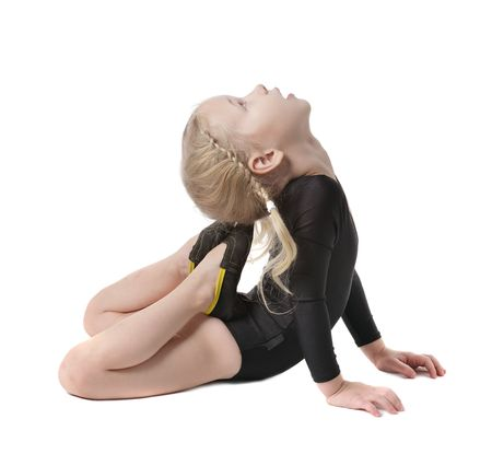 creative strength: little gymnast girl doing exercise isolated on white