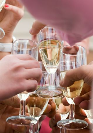 Hands holding the glasses of champagne making a toast Stock Photo - 5936397