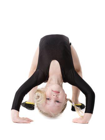 little gymnast girl doing exercise isolated on white photo