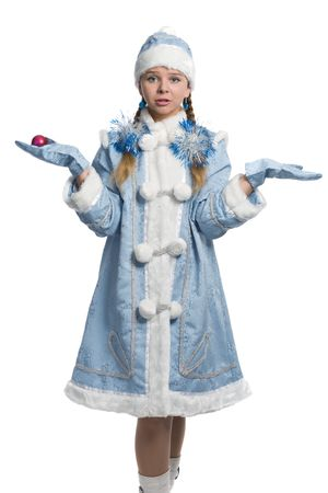 The confused snow maiden holds an christmas ball on a palm Stock Photo - 6009281