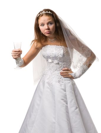 Drunk bride in a wedding dress with black eye stand akimbo, isolated on white Stock Photo - 6009280