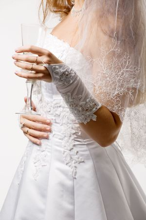 girl in a wedding-dress holds glass in a hand photo