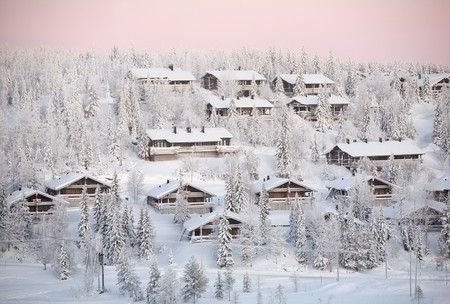 winter landscape with snow forest and wooden houses, Ruka village, Finland