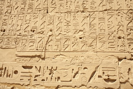 Egyptian hieroglyphs on the wall of ancient temple, Luxor, Karnak Temple photo