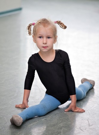 little gymnast girl doing the splits Stock Photo - 7916334