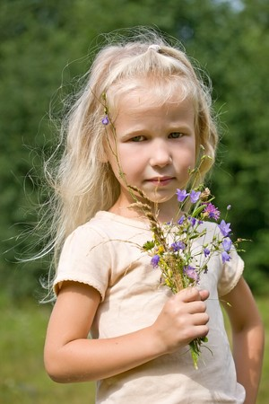 portrait of blonde girl with wild flowers Stock Photo - 8213890