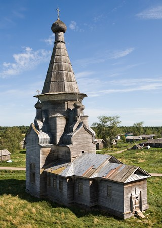 old wooden church in Russian village, summer view photo