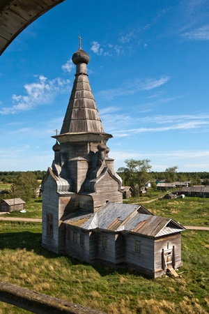old wooden Russian Orthodox church closeup on blue sky background, aerial view photo