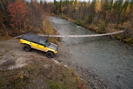 traverse: big four-wheel vehicle before crossing a river