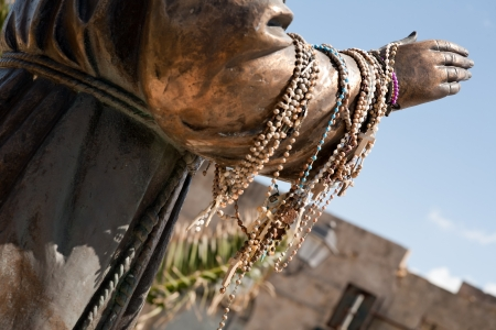 beads on a hand of priest statue, Castellammare del Golfo town, Sicily, Italy Stock Photo - 13639931