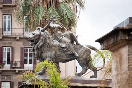 massimo: Statue of lyric opera (woman on a lion) standing before Teatro Massimo, Palermo, Italy