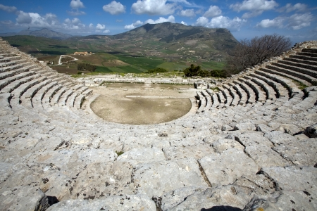 calatafimi: ancient Greek theatre, panorama view of beautiful mountains from the last row, Segesta village, Sicily, Italy