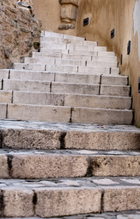 closeup of steps of stone stairway of Castellammare del Golfo town, Sicily, Italy photo