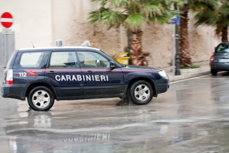 carabineer: Italian Carabinieri car with special notice on wet city street Editorial