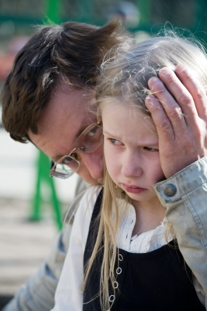 faces of father and sad weeping daughter closeup Stock Photo