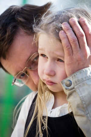 whining: faces of father and sad weeping daughter closeup Stock Photo