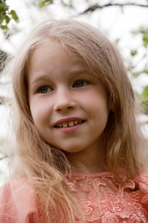 fair hair: little blonde girl closeup portrait on nature background