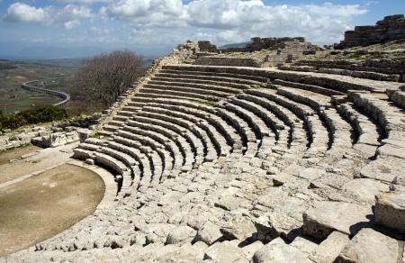 segesta: closeup of big white ancient Greek amphitheatre, Segesta village, Sicily, Italy Stock Photo