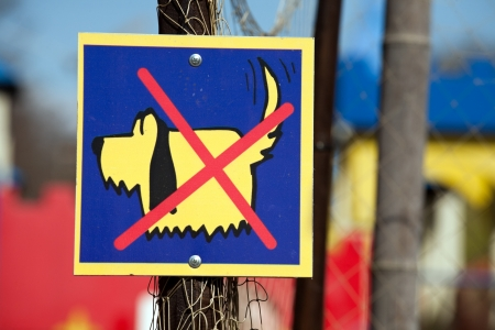interdict: No Dogs sign with funny little dog and red cross over it Stock Photo