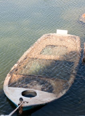 sunk: closeup of sunk boat under water surface