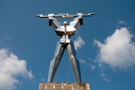 rumania: statue of iron man with lightning in hands, Romania Editorial
