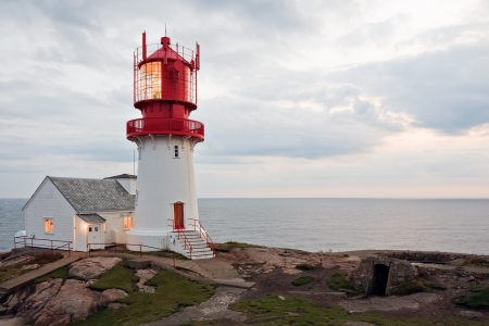 kristiansand: beautiful lighthouse on the edge of rocky sea coast, South Norway, Lindesnes Fyr beacon Stock Photo