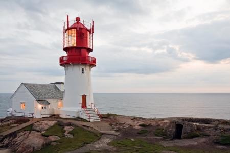 kristiansand: beautiful lighthouse on the edge of rocky sea coast, South Norway, Lindesnes Fyr beacon Stock Photo