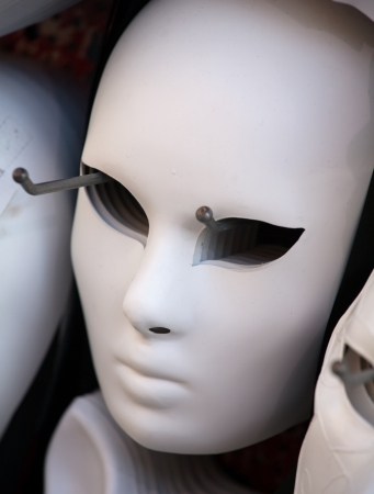 full face: half-finished white full face Venetian mask closeup