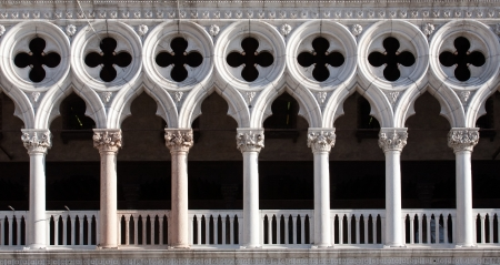 front view closeup of white Doges Palace white tracery facade in Venice