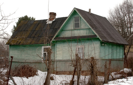 dacha: old abandoned green rural wooden house in Russian village