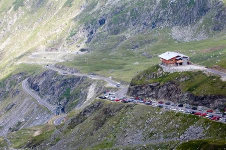 rumania: scenic top view of mountain pass and resort parking, Transfagarasan highway, Romania