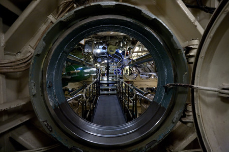 submarine view through manhole, interior with devices and technical equipment Editorial
