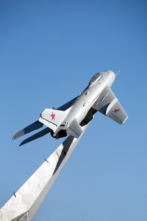 old soviet military airplane with red stars on wings monument  photo
