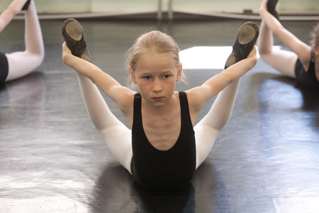 choreographic: small ballet girls training choreographic exercise on the floor Stock Photo