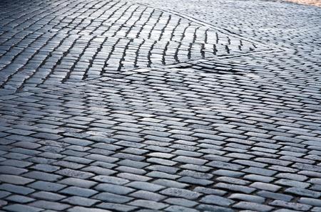 cobblestone street: grey cobblestone street pavement pattern closeup texture Stock Photo