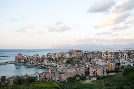 golfo: evening view on touristic harbour of Castellammare del Golfo town, Sicily, Italy
