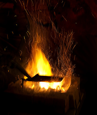 smithy: smithy fire flame tips with sparks closeup on dark background