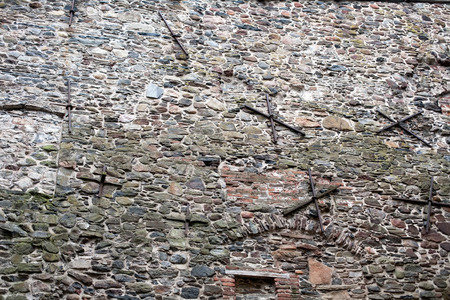 crampon: old fortress wall made from big stones masonry pattern background Stock Photo