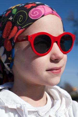 bandana girl: closeup portrait of young girl in bandana and big sunglasses