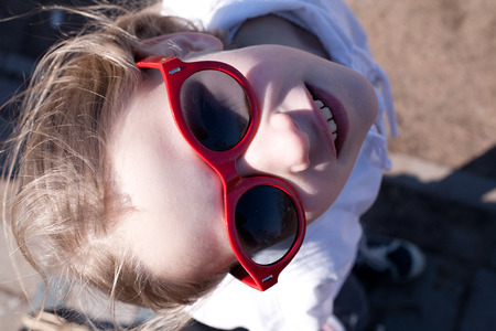 closeup portrait of cool young girl in big sunglasses photo