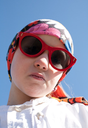 closeup portrait of cool young girl in bandana and big sunglasses photo