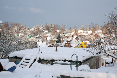 cramped: suburban settlement small wooden houses winter view on roofs covered by snow