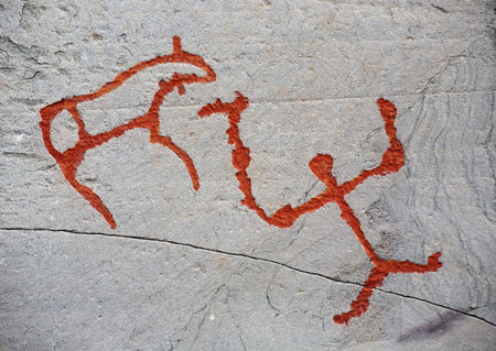 prehistoric rock carving petroglyphs on stone surface closeup, Alta, Norway