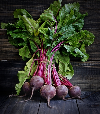 tabel: Big bunch of beet on the wooden tabel