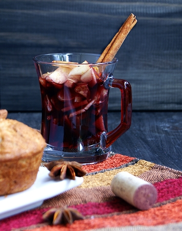 cup of hot Christmas mulled wine with cake photo