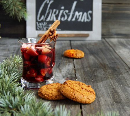 claret: cup of hot Christmas mulled wine with cake